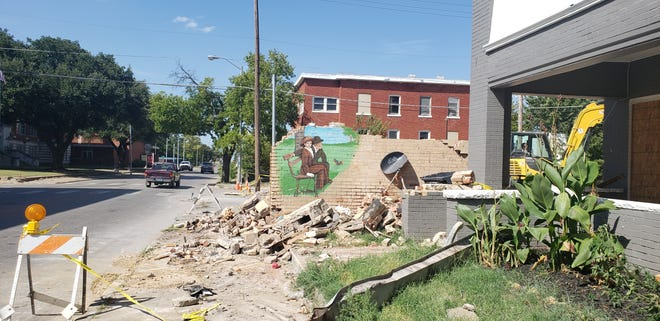 After a collapse during recent storms, a building on N Washington Street has been almost entirely removed.