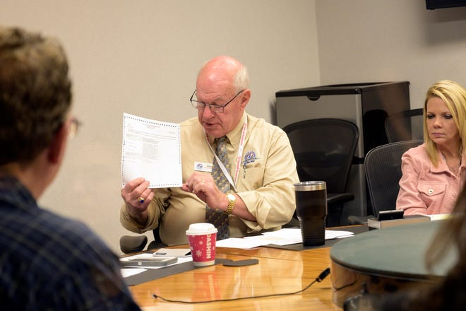 Alan Hays shows why a ballot must be duplicated during a recount on Friday, Nov. 8, 2019. [Cindy Peterson/Correspondent]