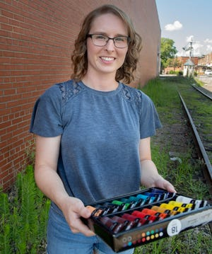 Artist Kelly Davis, who grew up in the Midway community and won a contest to paint the murals at the Lexington Farmers Market, now lives in Asheboro where she works for the NC Zoo.