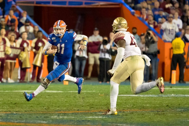 Florida quarterback Kyle Trask (11) scrambles during a 2019 game against Florida State. Amid rising doubt about the viability of college football this year, Gov. Ron DeSantis Monday urged teams to play on. [Matt Pendleton/Gainesville Sun Correspondent]