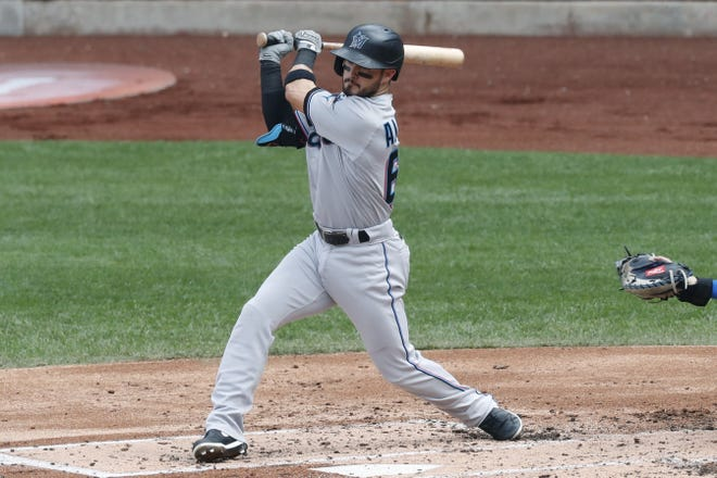 Miami Marlins infielder Eddy Alvarez swings on a single in a baseball game at Citi Field, Sunday, Aug. 9, 2020, in New York. [Kathy Willens/AP Photo]