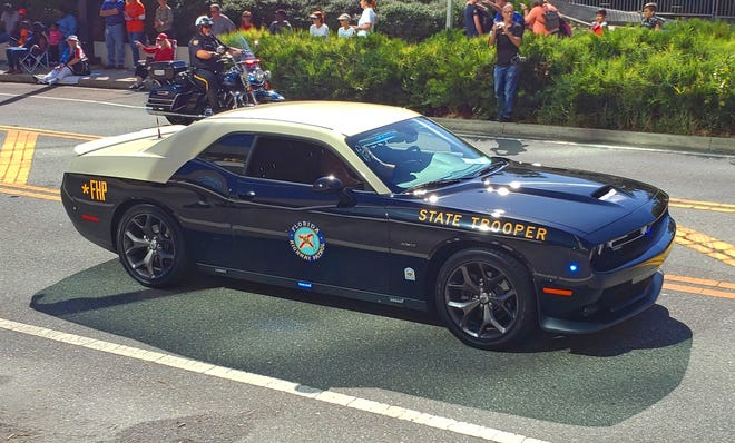 One of the Florida Highway Patrol's new Dodge Challenger pursuit vehicles cruised in Jacksonville's Veteran's Day parade.