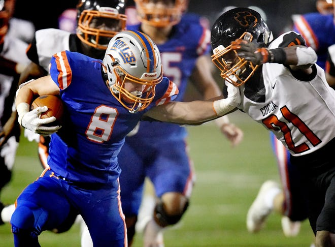 Bolles running back Kade Frew (8) pushes off Cocoa defender Cedrick Hawkins (21) in a Class 4A high school football semifinal in November 2019. The FHSAA's sports medicine advisory committee met Monday night to map out plans for fall sports. [Bob Self/Florida Times-Union]