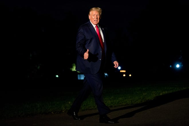 President Donald Trump gives a thumbs-up to members of the media as he walks across the South Lawn as he arrives at the White House on Sunday, after returning from Morristown, N.J. [Andrew Harnik/The Associated Press]