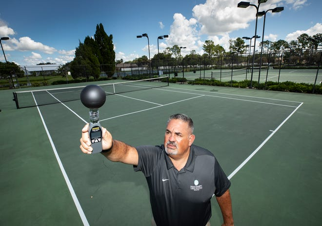Dan Talbot, senior coordinator of athletics for the Polk County Public Schools system, holds a Wet Bulb Globe Heat Monitor device in Lakeland. It is now state law that the device must be used on high school fields to hold activities. [ERNST PETERS/THE LEDGER]