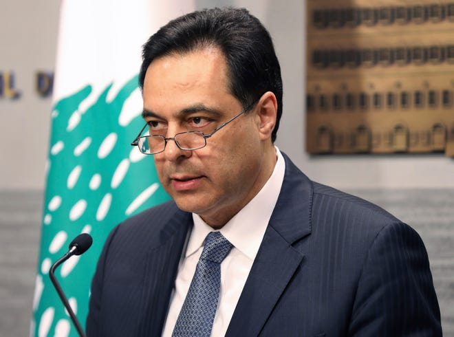Lebanese Prime Minister Hassan Diab, gives a speech in March at the Government House in Beirut, Lebanon. In a brief televised speech  Monday, Diab said he is stepping down from his job in the wake of the Beirut port explosion last week that triggered public fury and mass protests. [Dalati Nohra/The Associated Press]