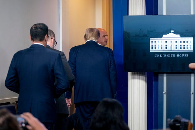 President Donald Trump is asked to leave the James Brady Press Briefing Room by a member of the U.S. Secret Service during a news conference at the White House on Monday.