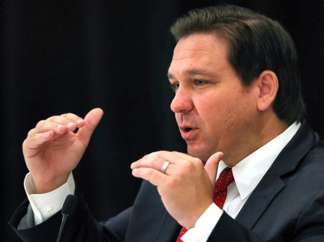 Florida Gov. Ron DeSantis answers a question during a roundtable meeting with transportation industry leaders at the Hilton Orlando-Bonnet Creek Resort in Orlando, Fla., Friday, Aug. 7, 2020. DeSantis addressed coronavirus and state transportation construction concerns.