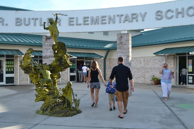 Students and parents walk into Butler Elementary School in 2018 on the first day of school.