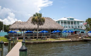 Evie's at Spanish Point is in Osprey overlooking Little Sarasota Bay. The tiki area is currently open with the new three-story restaurant seen in the background set to open in mid-September. [Herald-Tribune photo / Matt Houston]
