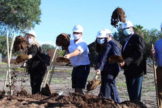 From left: Sarasota Mayor Jen Ahearn-Koch, City Commissioner Hagen Brody, State Rep. Margaret Good and City Commissioner Willie Shaw at a groundbreaking ceremony on Monday in north Sarasota. The Sarasota Housing Authority plans to build an 84-unit affordable senior housing apartment complex.  [HERALD-TRIBUNE STAFF PHOTO / TIMOTHY FANNING]