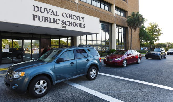 With horns honking, a motorcade of protesters passes the Duval County School Board building in July to protest plans to reopen schools in Jacksonville. [BOD SELF / FLORIDA TIMES-UNION]