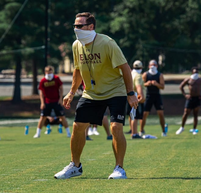 Elon football coach Tony Trisciani directs the Phoenix during a recent walkthrough session.