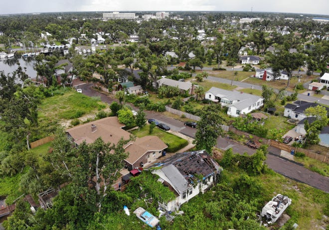 An aerial view shows a damaged home on Monday in Panama City. [PATTI BLAKE/THE NEWS HERALD]