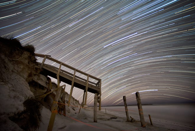 This long exposure composite photo shows about three hours of star trails over a broken observation boardwalk in St. Andrews State Park on January 7, 2019. Several park structures were damaged by Hurricane Michael on Oct.10, 2018 and remained untouched or roped off from the public almost for a year after the storm. [PATTI BLAKE/THE NEWS HERALD]
