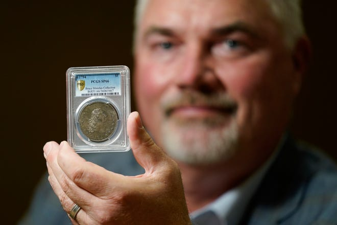Las Vegas collector Bruce Morelan with the 1794 U.S. silver dollar that is said to be among the first ever minted.
