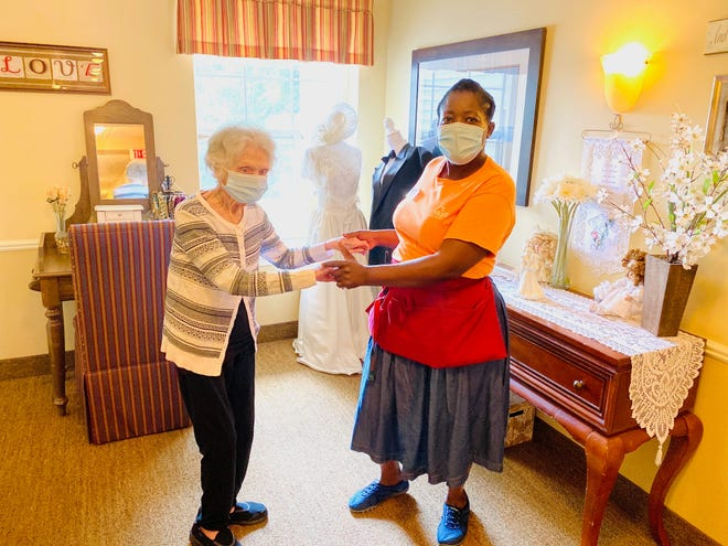 Anna Del Priore, left, dancing at Brighton Gardens, an assisted living facility in New Jersey. At age 107, Del Priore has now beat the coronavirus and Spanish Flu.