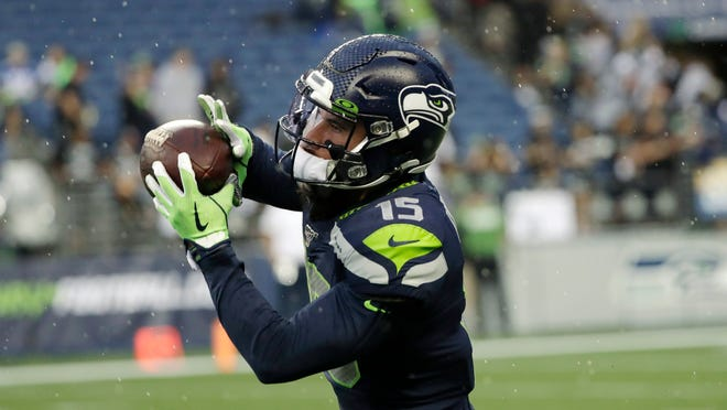 Seattle Seahawks wide receiver John Ursua makes a catch before an NFL football preseason game against the Oakland Raiders in  2019 in Seattle.