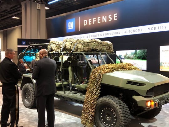 Vice Chief of Staff of the U.S. Army Joseph Martin (left) discusses the Infantry Squad Vehicle capabilities with David Albritton (right), president of GM Defense. They are at the 2019 annual Association of the U.S. Army (AUSA) conference in Washington, DC.