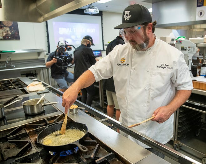 Josh Cooper stirs butter as he works on making a sugar cream pie creation during the filming of World Food Championships, at Ivy Tech Community College, Indianapolis, Sunday, Aug. 9, 2020. This final round of the weekend's competition pits three cooks in a sugar cream pie contest.