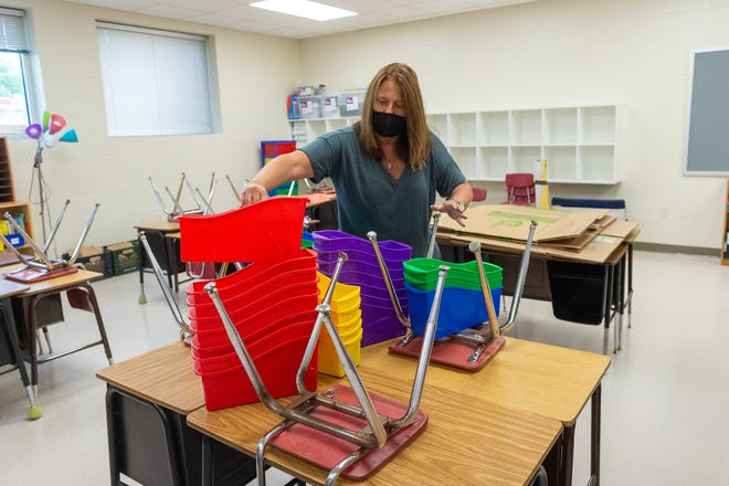 Third-grade teacher Rhonda Dupre setting up new classrooms at Broadmoor Elementary before Lafayette Parish schools open for fall 2020.