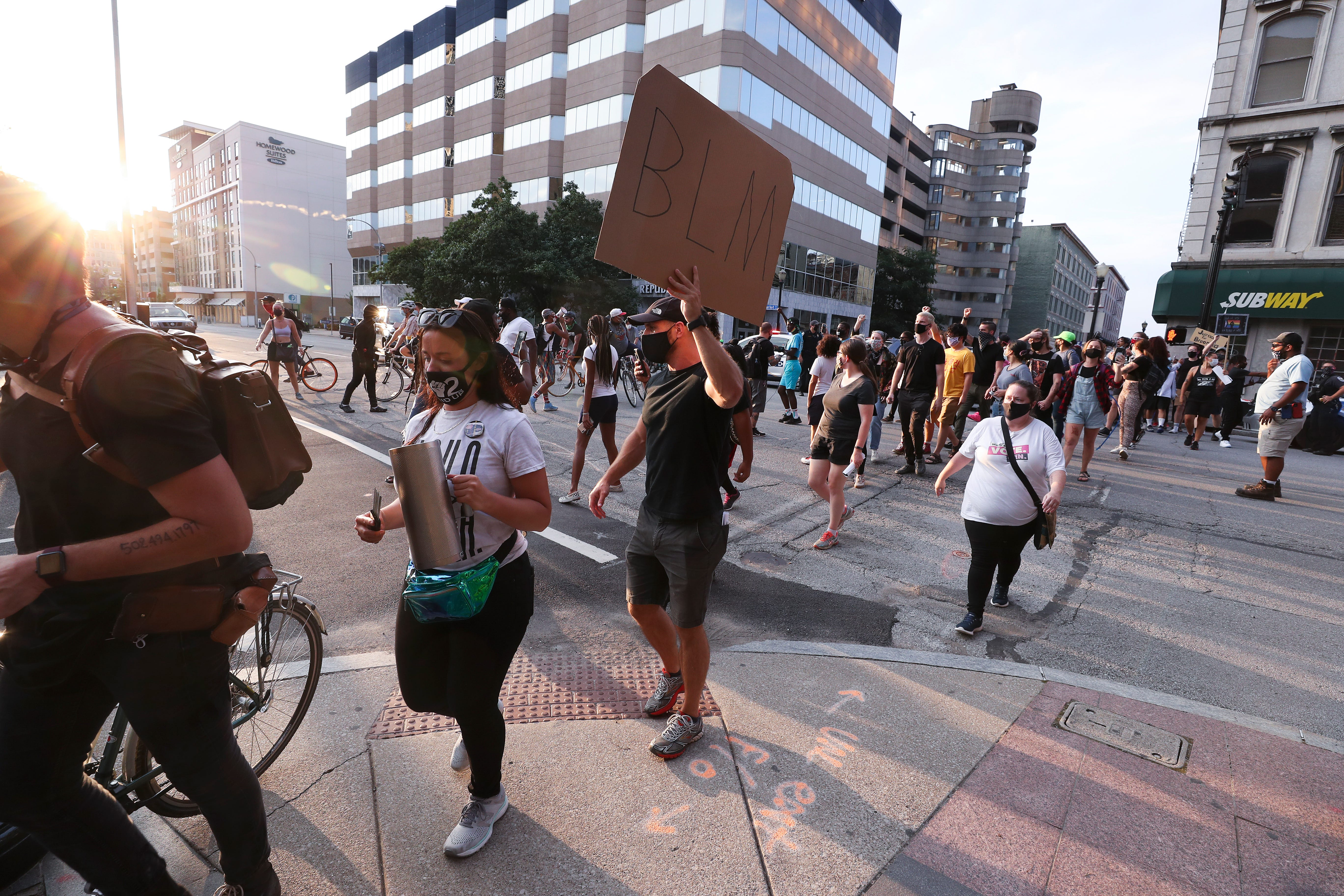 Protesters crossed the intersection of 6th and Market as they marched from the Ali Center to Jefferson Square Park in downtown Louisville on Aug. 9, 2020.  They avoided an encounter with police earlier.