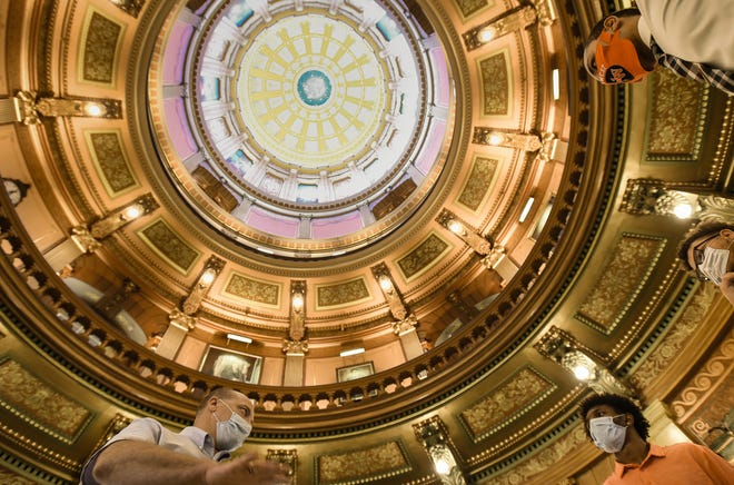 Michigan Capitol Education Director Matthew VanAcker, left, leads a tour of the Michigan State Capitol, Wednesday, Aug. 5, 2020.