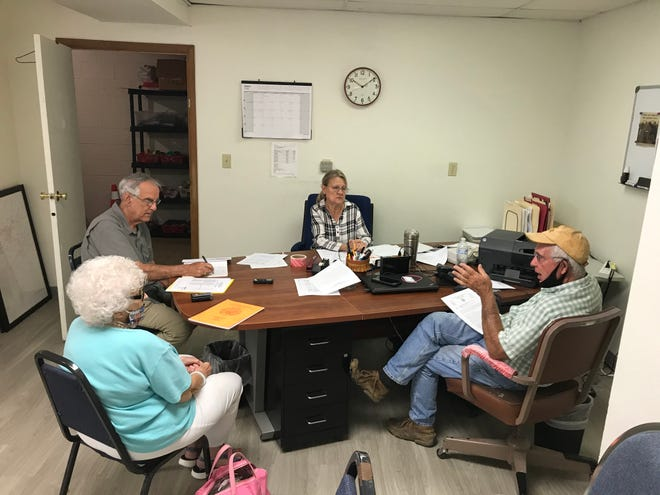 Baxter County poll worker Maryann Hoyne (far left) talks about the upcoming Nov. 3 election with Election Commission members (from left) Rick Peglar, Judy Garner and Bob Bodenhamer on Monday.