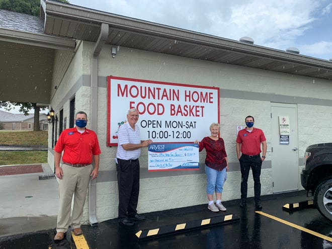 The Mountain Home Food Basket was recognized by Arvest Bank of North Central Arkansas as its Baxter County charity of the year. Pictured left to right are Zack Lashley, Arvest commercial banker; Bill Lucas, MH Food Bank grant coordinator; Barbara Summers, MH Food Bank president; and Jacob Bruggeman, Arvest commercial banker.