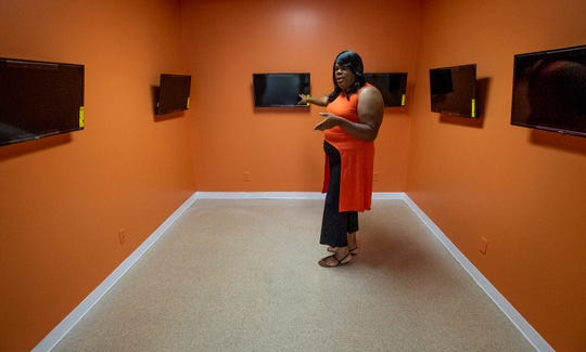 Lashawn Colvin shows where the gaming stations will be in the future site of her new comic book store in Montgomery, Ala., on Monday August 10, 2020.
