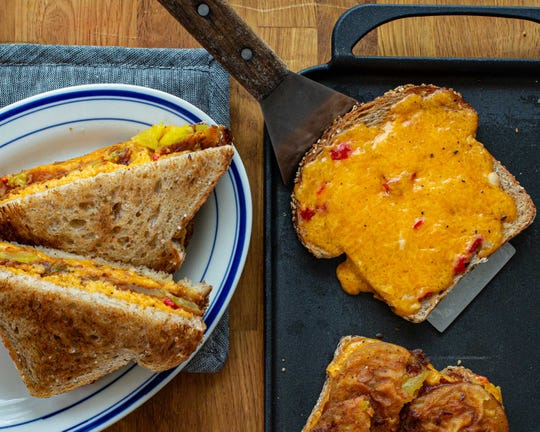 At Buttermilk Kitchen in Atlanta, Suzanne Vizethann makes a pimento cheese melt with pickled green tomatoes. (Courtesy of Gibbs Smith)
