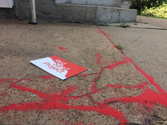Red sand filled cracks in sidewalks throughout Cheatham County last week as part of the Red Sand Project, hosted by the Cheatham County Community Enhancement Coalition to raise awareness of human trafficking.