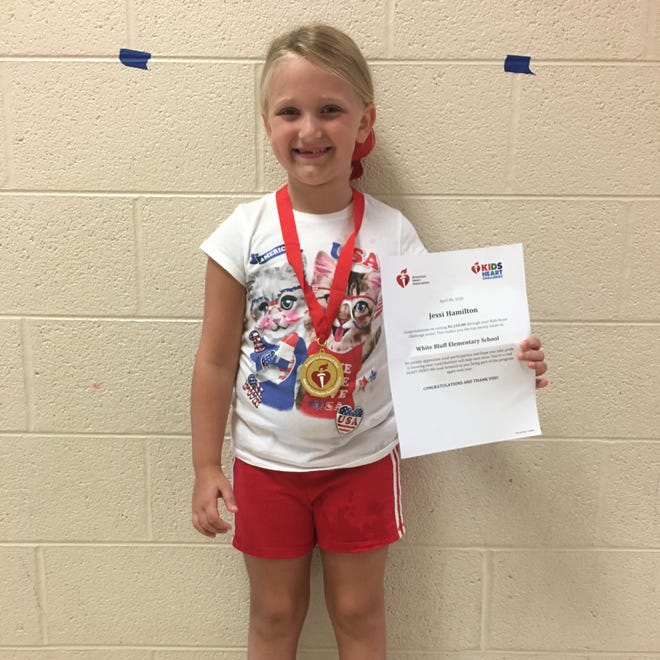 Jessi Hamilton is pictured with with her medal and certificate- naming her the top fundraiser at WBES.