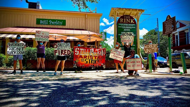 Baristas and their supporters picket outside the Still Perkin' coffeeshop in New Orleans.