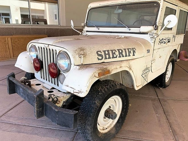 A vintage Doña Ana County Sheriff's Office jeep sits outside DASO headquarters on Monday, Aug. 10, 2020.