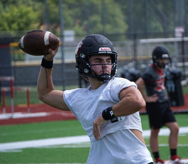 Livonia Churchill Charger QB Gavin Brooks gets ready to sling a pass during the team's Aug. 10, 2020 practice.