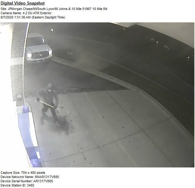 Oakland County Sheriff's deputies say the hooded individuals used a crowbar to bust up a Lyon Township ATM machine before escaping in this stolen truck.