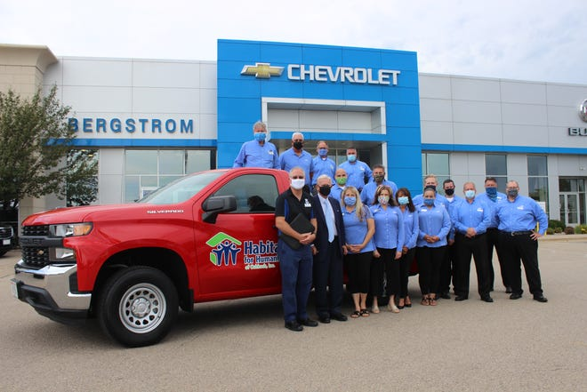 Bergstrom Automotive Group employees presented the truck to Habitat for Humanity Monday morning.