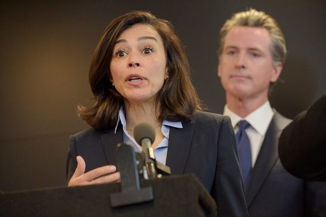 Dr. Sonia Angell speaks to members of the press at a news conference in Sacramento in February. Angell has resigned as director and state public health officer for the California Department of Public Health. (AP Photo/Randall Benton, File)