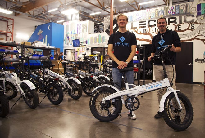 Founders of Lectric E-Bikes Robby Deziel, left, and Levi Conlow credit their success to influencers and reviews from YouTube.