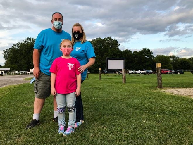 """Matthew Faulkner, wife Jamie Faulkner and daughter Charlotte Faulkner showed """"Grease"""" at the Beach Road Drive-In at Port Huron Township Memorial Park on Aug. 5, 2020."""