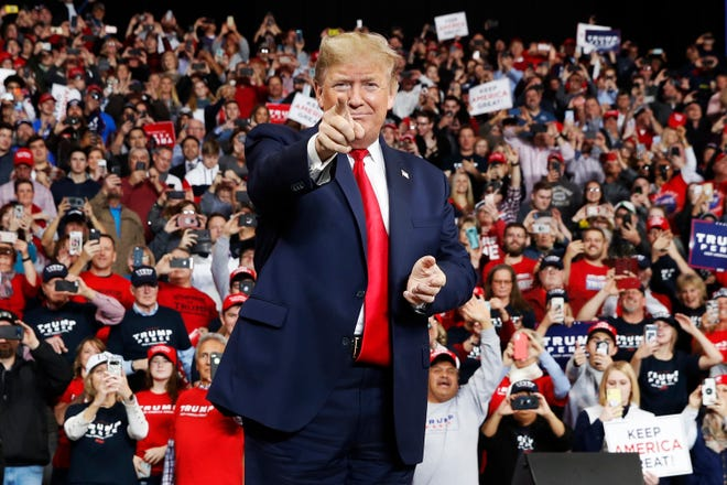 In this Jan. 9, 2020, file photo, President Donald Trump points as he arrives to speak at a campaign rally, in Toledo, Ohio. (AP Photo/ Jacquelyn Martin, File)