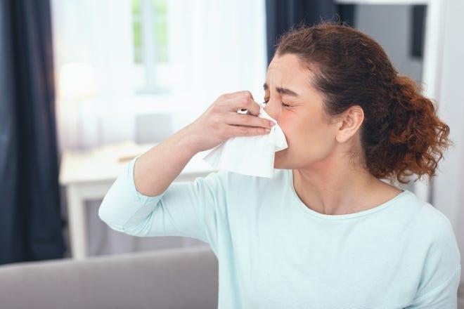 Woman sneezing (Dreamstime/TNS)