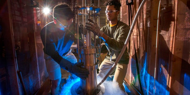 Students conducting research on high-voltage testing at FSU's Center for Advanced Power Systems