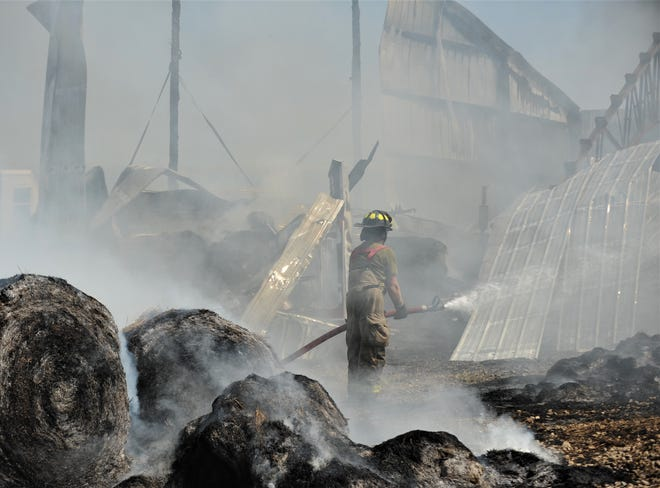 A hay barn was consumed by a Monday morning fire in Perry Township.
