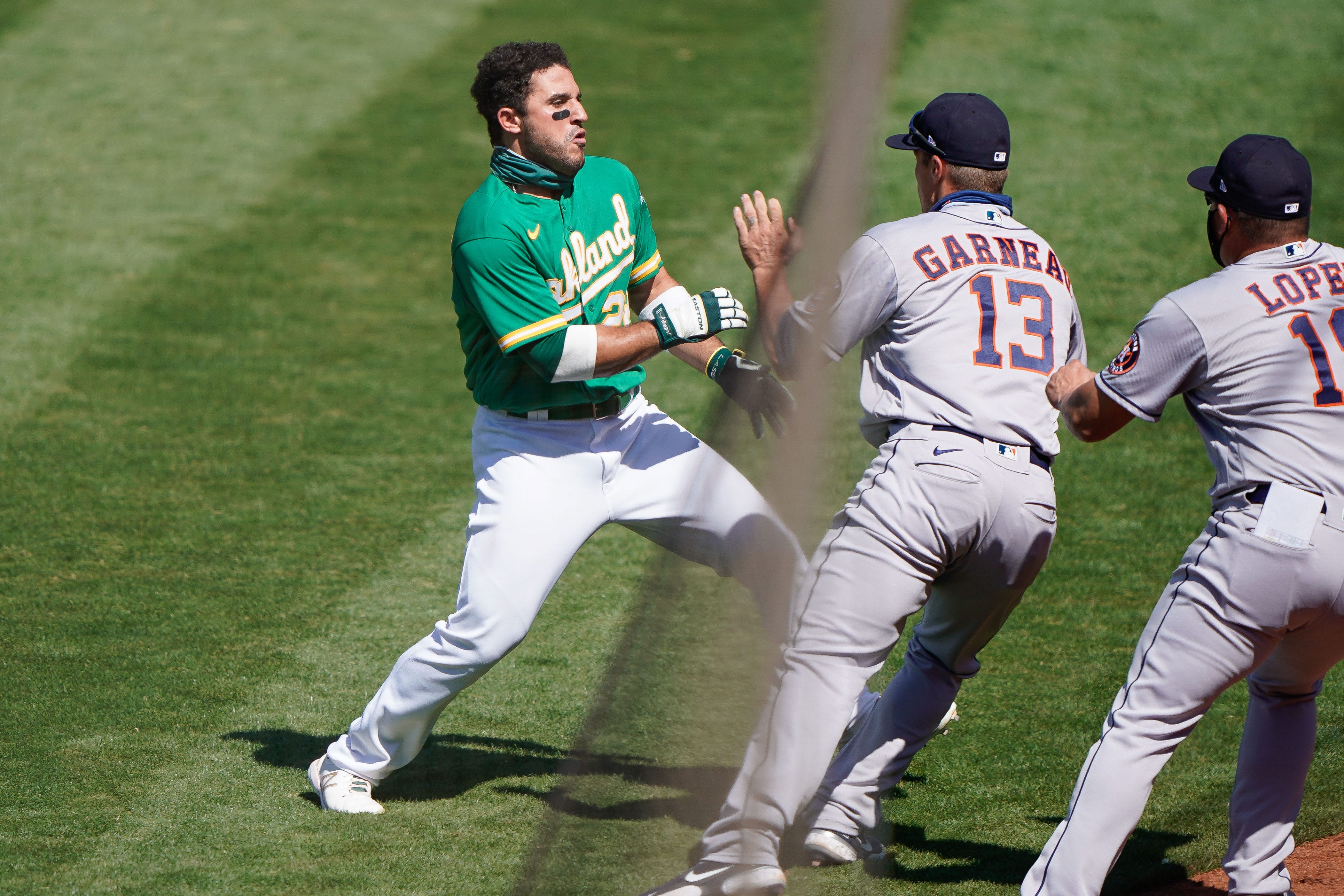 A's outfielder Ramon Laureano suspended six games, Astros coach Alex Cintrón gets 20 after brawl