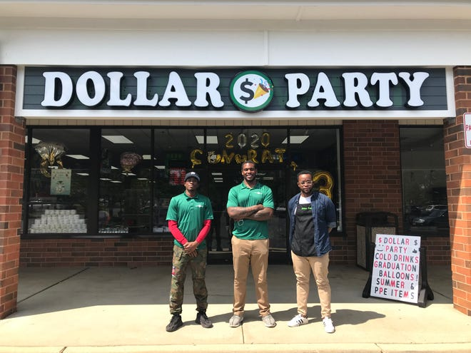 The three owners of Medford's new, and only dollar store, from left, Devin Garner, Dominique Easley and Emmanuel Ukpong.