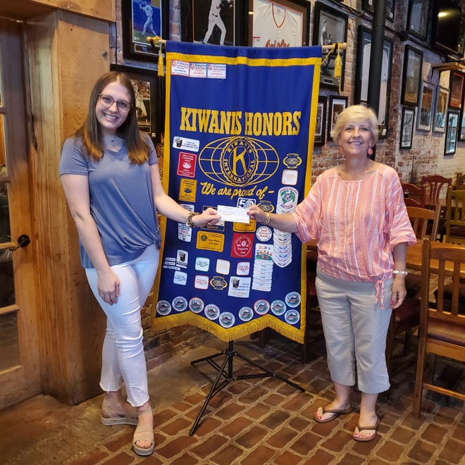 Jessica was presented her check by club president Monda Rutherford.