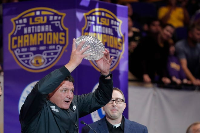 LSU head coach Ed Orgeron holds up the American Football Coaches Association National Championship Trophy during a celebration of their NCAA college football championship, Saturday, Jan. 18, 2020, on the LSU campus in Baton Rouge.