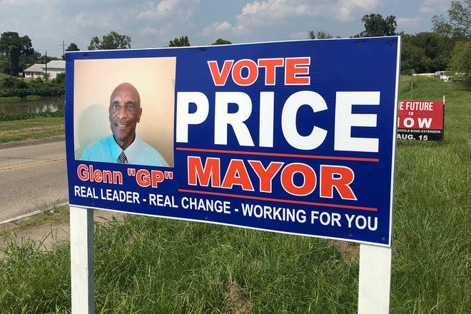 A campaign sign for Donaldsonville mayoral candidate Glenn Price sits along East Bayou Road, near the railroad underpass and Bayou Lafourche.